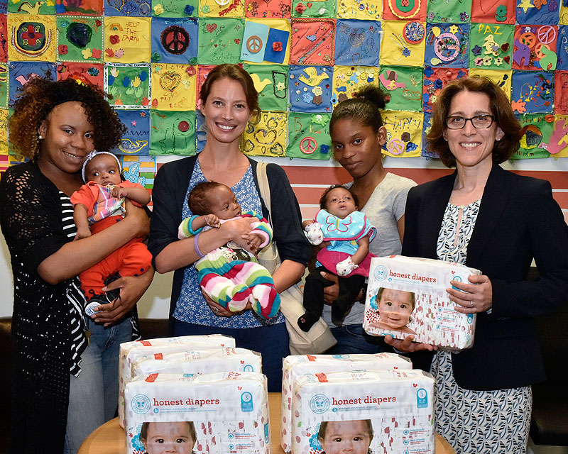 Domestic Violence Bureau Chief Michelle Kaminsky, model Christy Turlington and moms from the Family Justice Center pose with diapers donated by Every Mother Counts organization